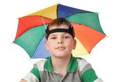Boy with multi-coloured umbrella on head isolated Royalty Free Stock Photography