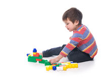 Boy with multicolored bricks Stock Photos