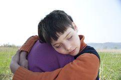 The boy with mum. The white boy in обятиях mums has put a head on a shoulder Royalty Free Stock Images
