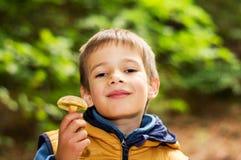 Boy with mushroom Stock Image