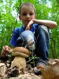 Boy with mushroom. Royalty Free Stock Photo