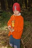 Boy and mushrooms Stock Photos