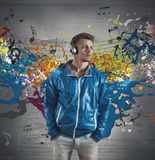 Boy and music note splashing. Concept of music with note splashing Royalty Free Stock Image