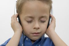 Boy / music / white Royalty Free Stock Photo