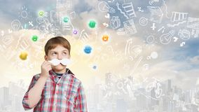 Boy with mustache. Kid boy having fun with decorative mustache over colorful background Stock Image