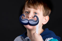Boy with Mustache Prop Royalty Free Stock Photo