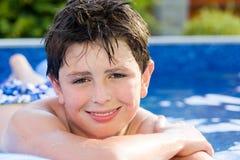 Boy na piscina Imagens de Stock Royalty Free