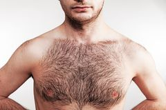 Boy with naked hairy chest on white background. Boy with naked hairy chest Royalty Free Stock Photo