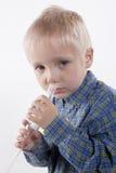 Boy and nasal aspirator Stock Image