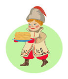 Boy in  national clothes  with pancakes. A Shrovetide. Royalty Free Stock Images