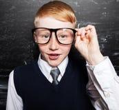 Boy near blackboard Stock Image