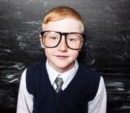 Boy near blackboard Stock Photography