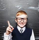 Boy near blackboard Royalty Free Stock Photo
