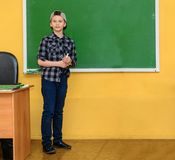 Boy near the blackboard in the classroom. Stock Images