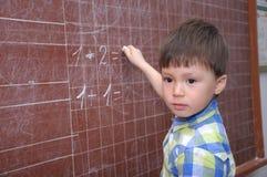 Boy near the blackboard Stock Photography