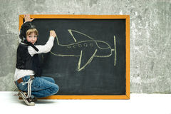 Boy near blackboard Royalty Free Stock Photos