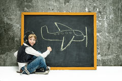 Boy near blackboard Royalty Free Stock Images
