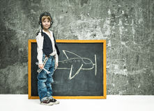 Boy near blackboard Stock Photo