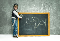 Boy near blackboard Royalty Free Stock Photo