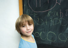 Boy near the blackboard Stock Photo