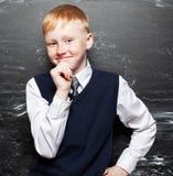 Boy near blackboard Stock Photo