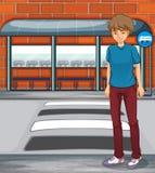 A boy near the bus stop Royalty Free Stock Photos