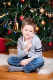 Boy near Christmas tree Royalty Free Stock Photo