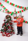 Boy near a Christmas tree on a white background. Boy near a Christmas tree on a white background Stock Images