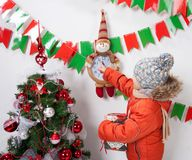 Boy near a Christmas tree on a white background. Boy near a Christmas tree on a white background Stock Image