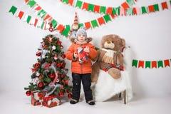 Boy near a Christmas tree on a white background. Boy near a Christmas tree on a white background Stock Photography