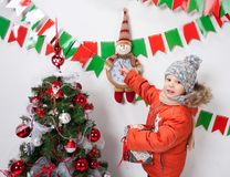 Boy near a Christmas tree on a white background. Boy near a Christmas tree on a white background Royalty Free Stock Photography