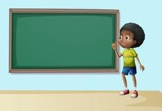 A boy near the empty blackboard Royalty Free Stock Images