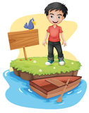 A boy near the empty signboard with a bird Stock Photography