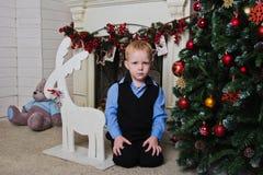 Boy near fireplace Royalty Free Stock Photography