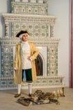 Boy near the fireplace Royalty Free Stock Photo