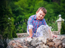 Boy near the fountain Royalty Free Stock Photos