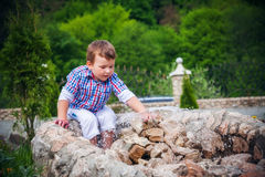 Boy near the fountain in summer Royalty Free Stock Photo