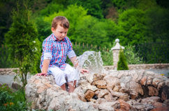 Boy near the fountain in summer Royalty Free Stock Photos