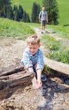 Boy near mountain stream Royalty Free Stock Photo