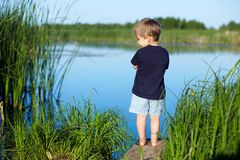 Boy near the river Royalty Free Stock Photo