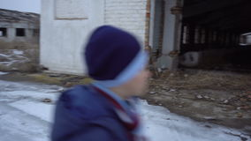 The boy is near the ruined farm stock footage