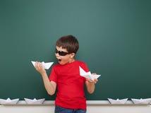 Boy near school board Stock Images