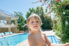 Boy near swimming pool Stock Images