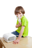The boy with nebulizer Royalty Free Stock Image