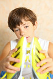Boy with new soccer boots. Brand new yellow soccer boots . Boy with new soccer boots Stock Photo