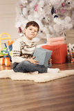 Boy with New Year presents Stock Images