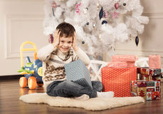 Boy with New Year presents Royalty Free Stock Images