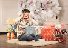 Boy with New Year presents Stock Image