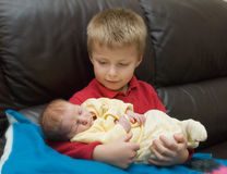 Boy and newborn sibling Royalty Free Stock Photography