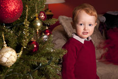 Boy next to Christmas tree Royalty Free Stock Images